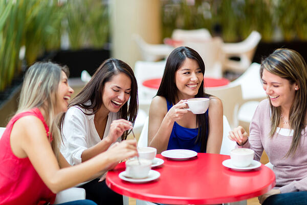 Group of girl friends meeting for coffee and talk-1